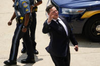 CEO Elon Musk departs from the justice center in Wilmington, Del., Tuesday, July 13, 2021. Testifying for a second day, Musk pushed back again Tuesday against a lawsuit that blames him for engineering Tesla's 2016 acquisition of a financially precarious company called SolarCity that was marred by conflicts of interest and never generated the profits Musk insisted it would. (AP Photo/Matt Rourke)