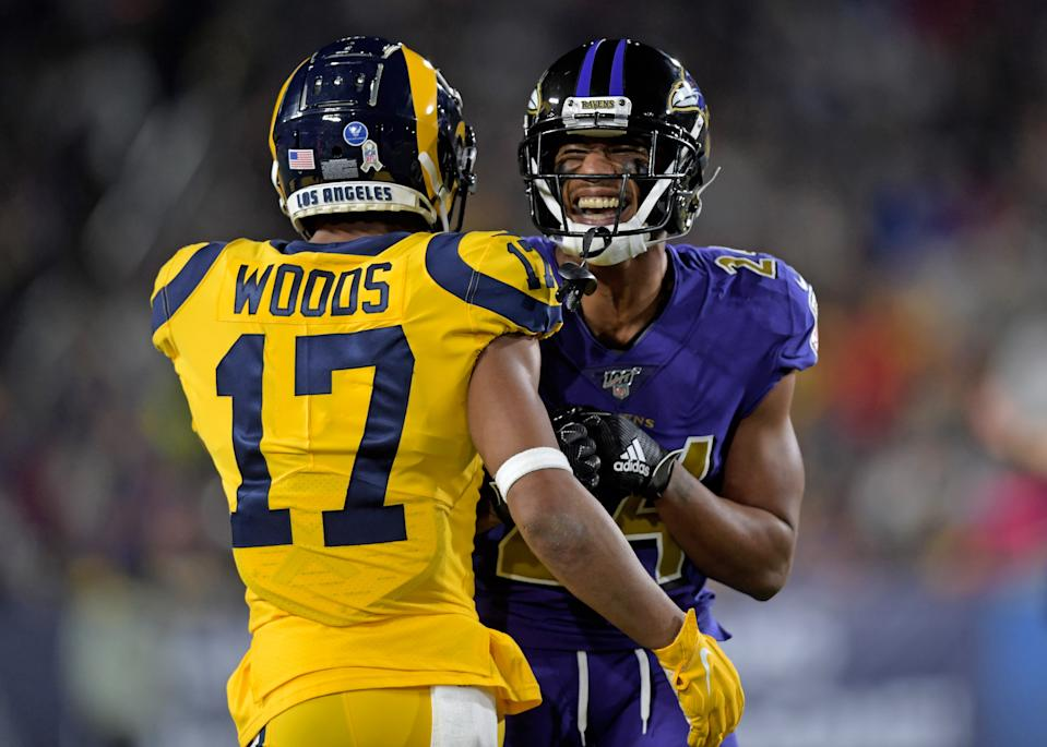 Nov 25, 2019; Los Angeles, CA, USA; Los Angeles Rams wide receiver Robert Woods (17) and Baltimore Ravens cornerback Marcus Peters (24) talk during the first half at Los Angeles Memorial Coliseum. Mandatory Credit: Kirby Lee-USA TODAY Sports