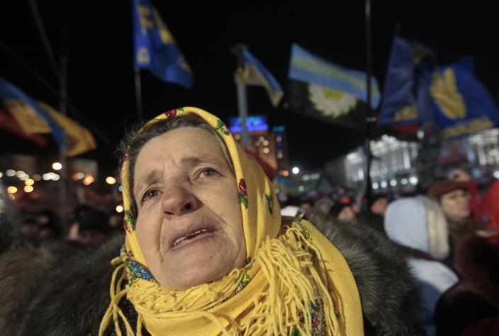 A Pro-European Union activist listens to a speaker on the Independence Square in Kiev, Ukraine, Tuesday, Dec. 10, 2013. Top Western diplomats headed to Kiev Tuesday to try to defuse a standoff between President Viktor Yanukovych's government and thousands of demonstrators, following a night in which police in riot gear dismantled protesters' encampments outside government buildings. (AP Photo/Sergei Chuzavkov)
