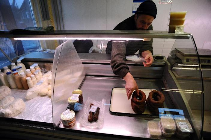 """Voskresenskoye farmer Stanislav Kushevich, seen in his butcher's shop nearby, says: """"I have no savings, and I spend everything I make on my farm. I've never travelled abroad, nor bought imported goods."""" (AFP Photo/Olga Maltseva)"""