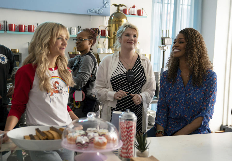 "This image released by Focus Features shows Carey Mulligan, left, Emerald Fennell and Laverne Cox on the set of ""Promising Young Woman."" (Focus Features via AP)"