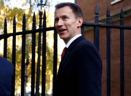 Britain's Foreign Secretary, Jeremy Hunt, leaves 10 Downing Street, in London