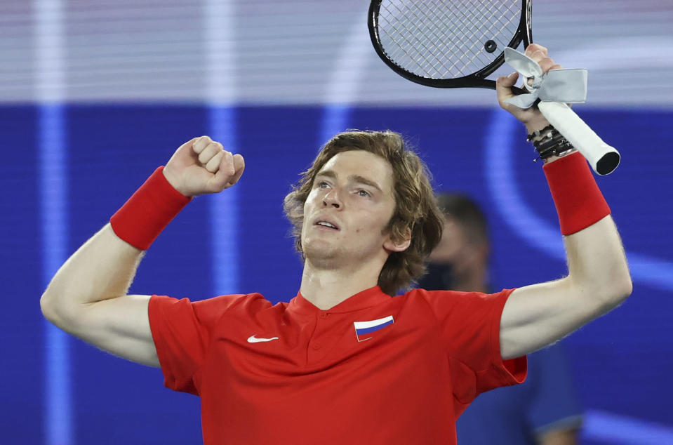 Russia's Andrey Rublev celebrates after defeating Italy's Fabio Fognini in the ATP Cup final in Melbourne, Australia, Sunday, Feb. 7, 2021.(AP Photo/Hamish Blair)