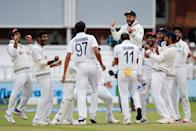 <p>Cricket - Second Test - England v India - Lord's Cricket Ground, London, Britain - August 16, 2021 India's Ishant Sharma celebrates taking the wicket of England's Jonny Bairstow with Virat Kohli and teammates Action Images via Reuters/Paul Childs TPX IMAGES OF THE DAY</p>
