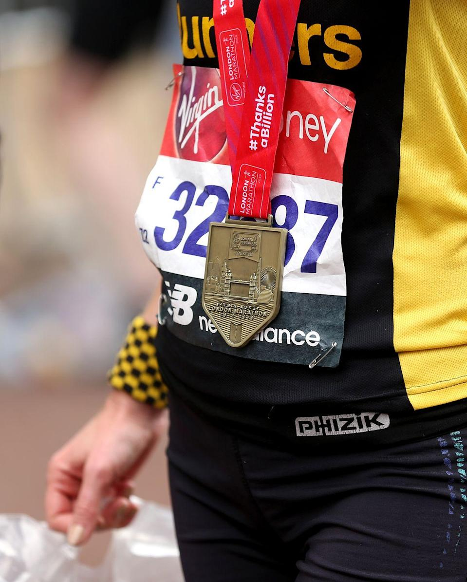 """<p>We finished the race. We earned the medal. So why wouldn't we wear it to brunch…and dinner…and the hotel continental breakfast the next morning…and on the plane…and to the office on Monday…<a href=""""https://www.runnersworld.com/runners-stories/a27731606/how-long-should-you-wear-your-race-medal/"""" rel=""""nofollow noopener"""" target=""""_blank"""" data-ylk=""""slk:and possibly Tuesday"""" class=""""link rapid-noclick-resp"""">and possibly Tuesday</a>.</p>"""