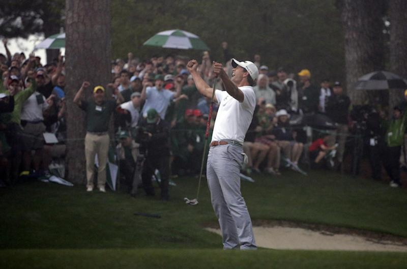 Adam Scott, of Australia, celebrates after making a birdie putt on the second playoff hole to win the Masters golf tournament Sunday, April 14, 2013, in Augusta, Ga. (AP Photo/Charlie Riedel)