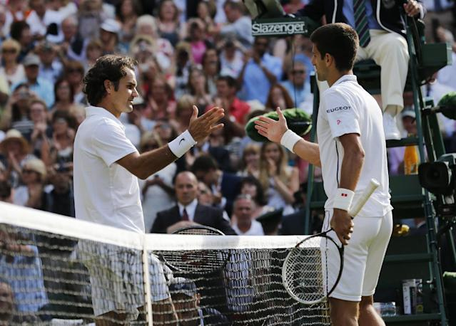 Novak Djokovic of Serbia, right, shakes hands after defeating Roger Federer of Switzerland in the men's singles final at the All England Lawn Tennis Championships in Wimbledon, London, Sunday July 6, 2014. (AP Photo/Ben Curtis)