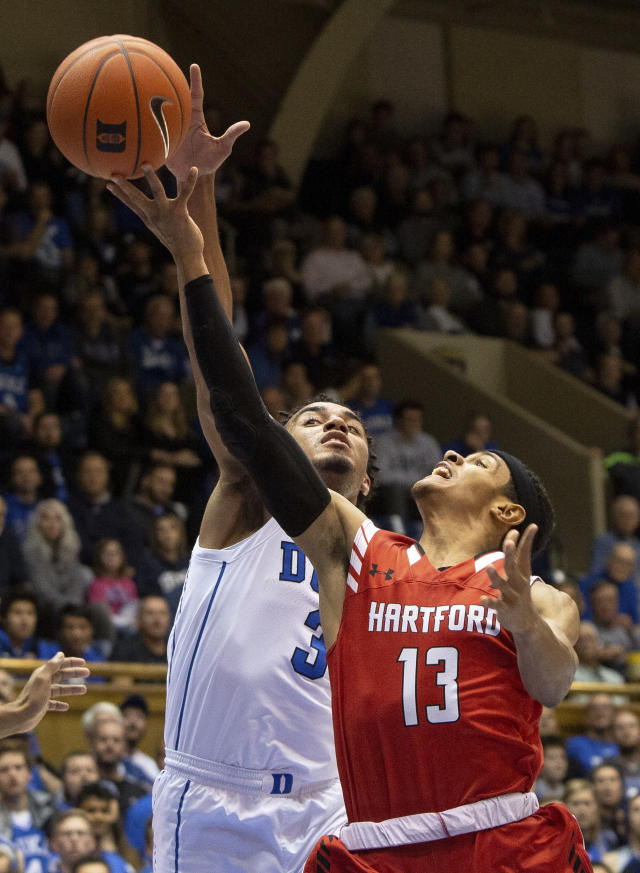 Hartford's J.R. Lynch (13) attempts a shot as Duke's Tre Jones (3) defends during the first half of an NCAA college basketball game in Durham, N.C., Wednesday, Dec. 5, 2018. (AP Photo/Ben McKeown)