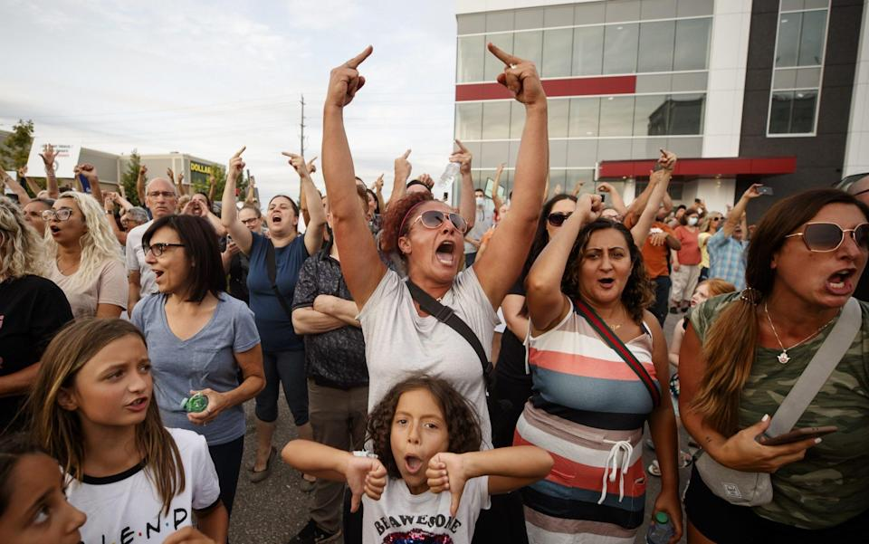Demonstrators cheer after it's announced that an outdoor rally planned for Justin Trudeau, Canada's prime minister, is cancelled, in Bolton, Ontario, Canada - Bloomberg