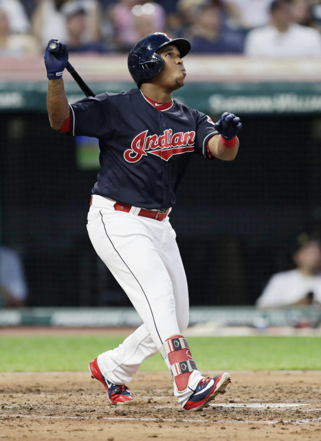 Cleveland Indians' Jose Ramirez watches his ball after hitting a sacrifice fly off Minnesota Twins starting pitcher Kyle Gibson in the third inning of a baseball game, Tuesday, Aug. 28, 2018, in Cleveland. Francisco Lindor scored on the play. (AP Photo/Tony Dejak)