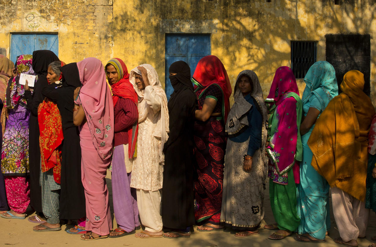 <p>Indian women stand in a queue to cast their votes at a village near Amroha in Uttar Pradesh, India, Feb. 15, 2017. (Photo: Manish Swarup/AP) </p>