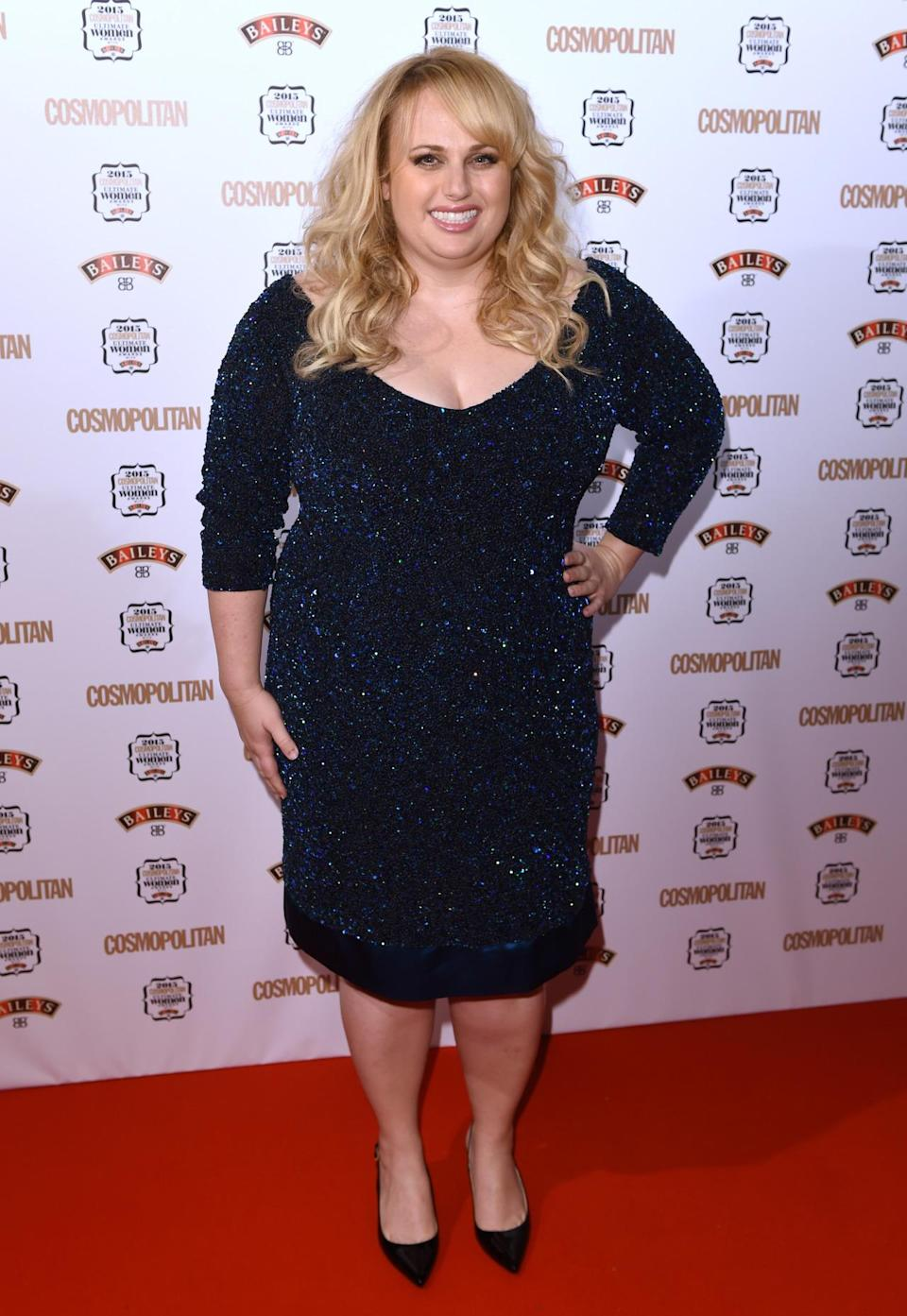 Taking home the Ultimate Woman Award, Rebel Wilson looked stunning in a glittering midnight blue frock. [Photo: Rex]