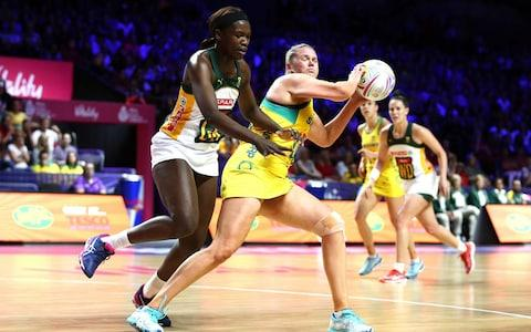 <span>Australia's Caitlin Thwaites and South Africa's Phumza Maweni battle for the ball </span> <span>Credit: PA </span>