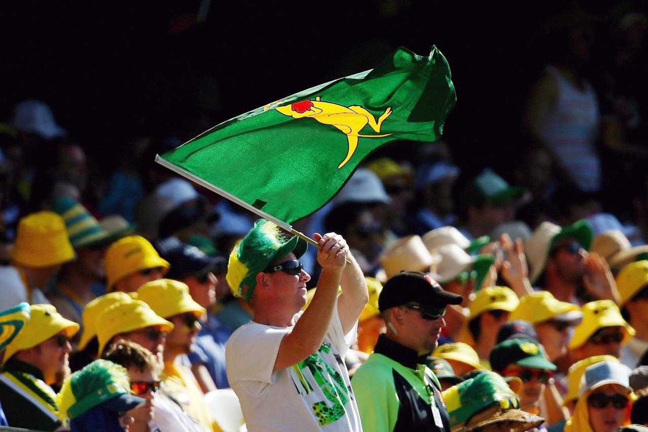 BRISBANE, AUSTRALIA - NOVEMBER 23:  A spectator in the crowd waves a boxing kangaroo flag during day three of the First Ashes Test match between Australia and England at The Gabba on November 23, 2013 in Brisbane, Australia.  (Photo by Mark Kolbe/Getty Images)
