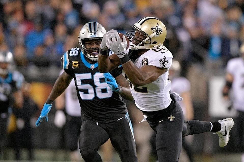 New Orleans tight end Benjamin Watson, shown catching a pass while Carolina's Thomas Davis watches, called out NFL commissioner Roger Goodell for inaction in the wake of the Saints controversial NFL playoff loss (AFP Photo/GRANT HALVERSON)