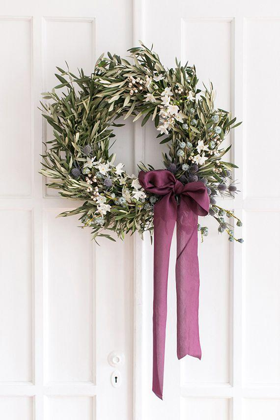 """<p>You can customize this DIY with colors to match the rest of your <a rel=""""nofollow"""" href=""""https://www.countryliving.com/home-design/decorating-ideas/advice/g1247/holiday-decorating-1208/"""">holiday decor</a>.</p><p><strong>Get the tutorial at <a rel=""""nofollow"""" href=""""http://www.100layercake.com/party-entertaining-ideas/diy-blue-white-olive-holiday-wreath-winter-decor/"""">100 Layer Cake</a>.</strong></p><p><strong><a rel=""""nofollow"""" href=""""https://www.amazon.com/Floral-Green-Wreath-Design-Inch/dp/B01FJ4VZIC"""">SHOP FOAM RINGS</a><br></strong></p>"""
