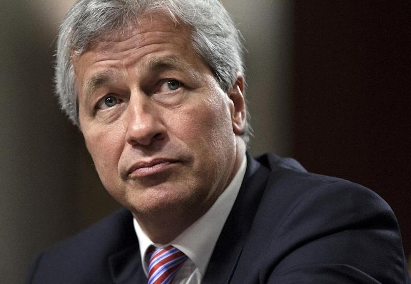 FILE - In this Wednesday, June 13, 2012, file photo, JPMorgan Chase CEO Jamie Dimon, head of the largest bank in the United States, testifies before the Senate Banking Committee on Capitol Hill in Washington. Dimon, chairman and CEO of the biggest U.S. bank, faces a key test this week: His shareholders are voting on whether to let him keep both jobs. (AP Photo/J. Scott Applewhite, File)