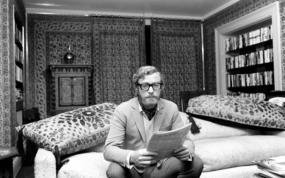 Actor Michael Caine pictured at his home in Grosvenor Square, also pictured is girlfriend Minda Feliciano from the Philippines. November 1969 Z11244-006 (Photo by Mirrorpix/Mirrorpix via Getty Images)  - Getty