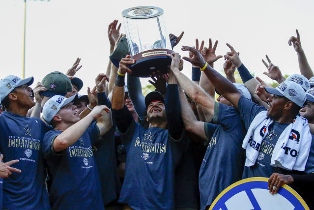 Vanderbilt celebrates with the trophy after defeating Mississippi to win the Southeastern Conference tournament NCAA college baseball championship game, Sunday, May 26, 2019, in Hoover, Ala. (AP Photo/Butch Dill)