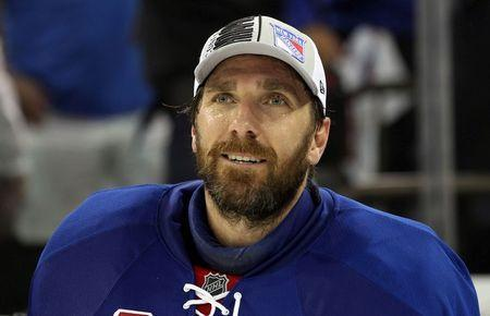 May 29, 2014; New York, NY, USA; New York Rangers goalie Henrik Lundqvist (30) after beating the Montreal Canadiens 1-0 in game six of the Eastern Conference Final of the 2014 Stanley Cup Playoffs at Madison Square Garden. Mandatory Credit: Adam Hunger-USA TODAY Sports