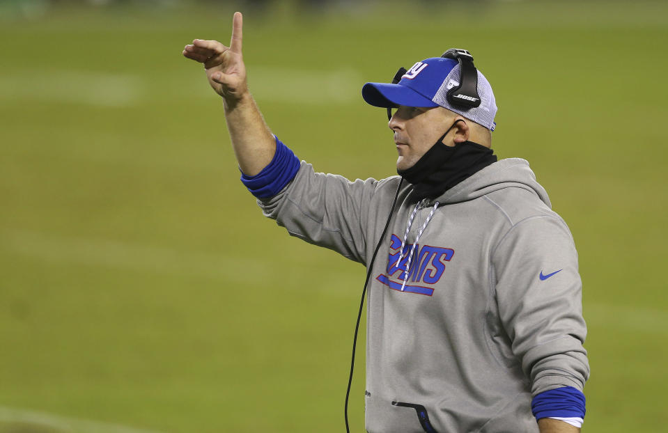 FILE - In this Oct. 22, 2020, file photo, New York Giants coach Joe Judge gestures during the team's NFL football game against the Philadelphia Eagles in Philadelphia. The Giants play the Tampa Bay Buccaneers this week. The game will feature six-time Super Bowl champion Tom Brady against Judge, one of his former coaches with the New England Patriots. The two shared three Super Bowl wins. The Bucs have a 5-2 record. Their only loss in the recent run was a one-point decision to Chicago. The Giants are 1-6 under the 38-year-old Judge. (AP Photo/Rich Schultz, File)