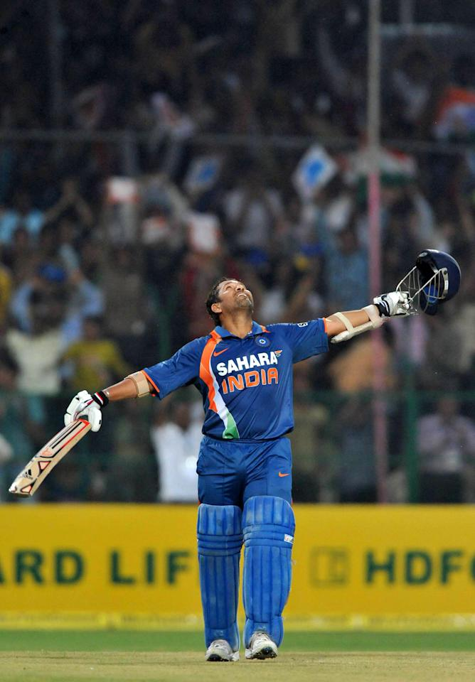 GWALIOR, INDIA - FEBRUARY 24: Sachin Tendulkar of India celebrates his 200, the first ever double hundred in a one day international, during the 2nd ODI between India and South Africa at Captain Roop Singh Stadium on February 24, 2010 in Gwalior, India. (Photo by Duif du Toit/Gallo Images/Getty Images)