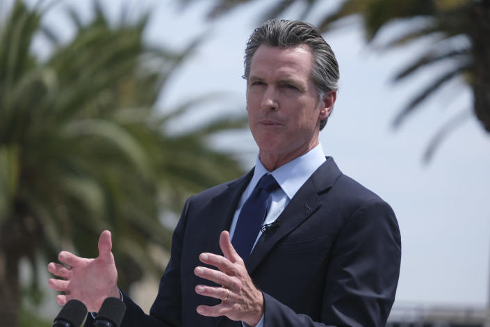 FILE - In this June 15, 2021, file photo California Gov. Gavin Newsom talks during a news conference at Universal Studios in Universal City, Calif. California on Saturday released a list of 41 people who filed the required paperwork to run in the Sept. 14 recall election that could remove Newsom from office. (AP Photo/Ringo H.W. Chiu, File)