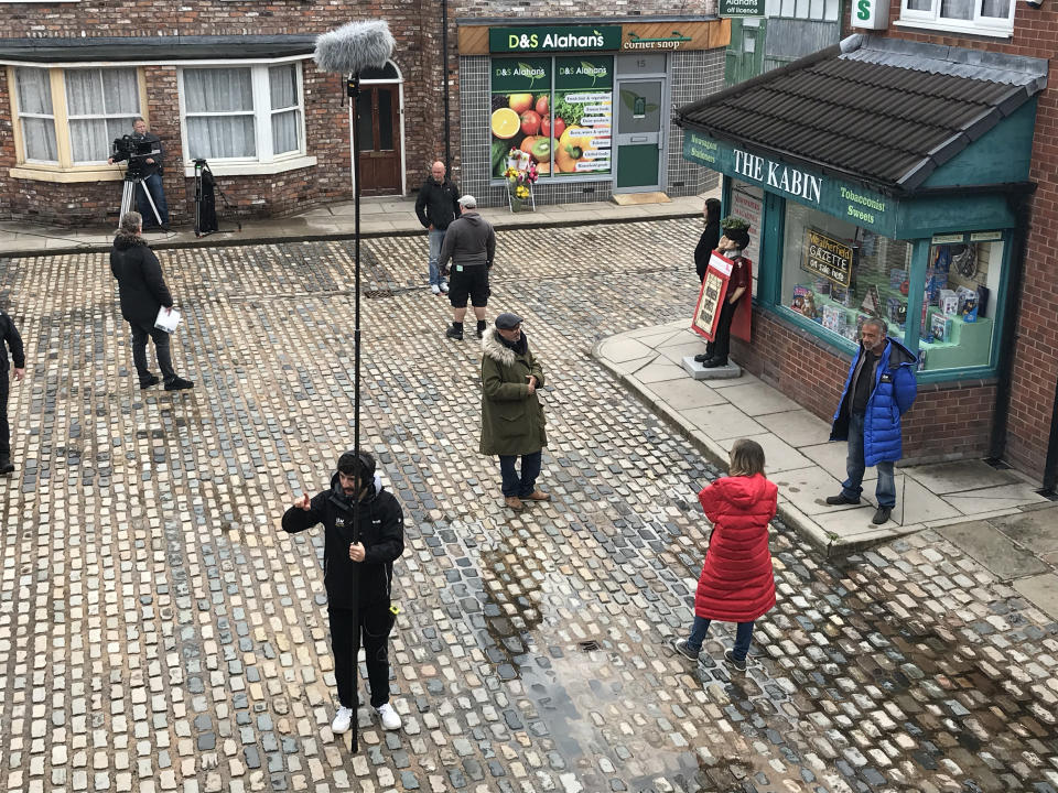 'Corrie' cast and crew keeping their distance on set. (ITV)