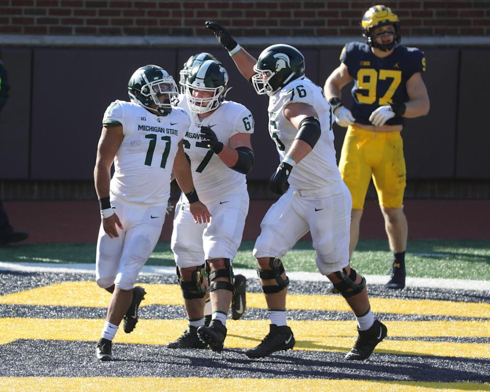 Michigan State Spartans running back Connor Heyward (11) celebrates with teammates after scoring a touchdown on a screen pass in the fourth quarter against the Michigan Wolverines at Michigan Stadium in Ann Arbor, Saturday, Oct. 31, 2020.