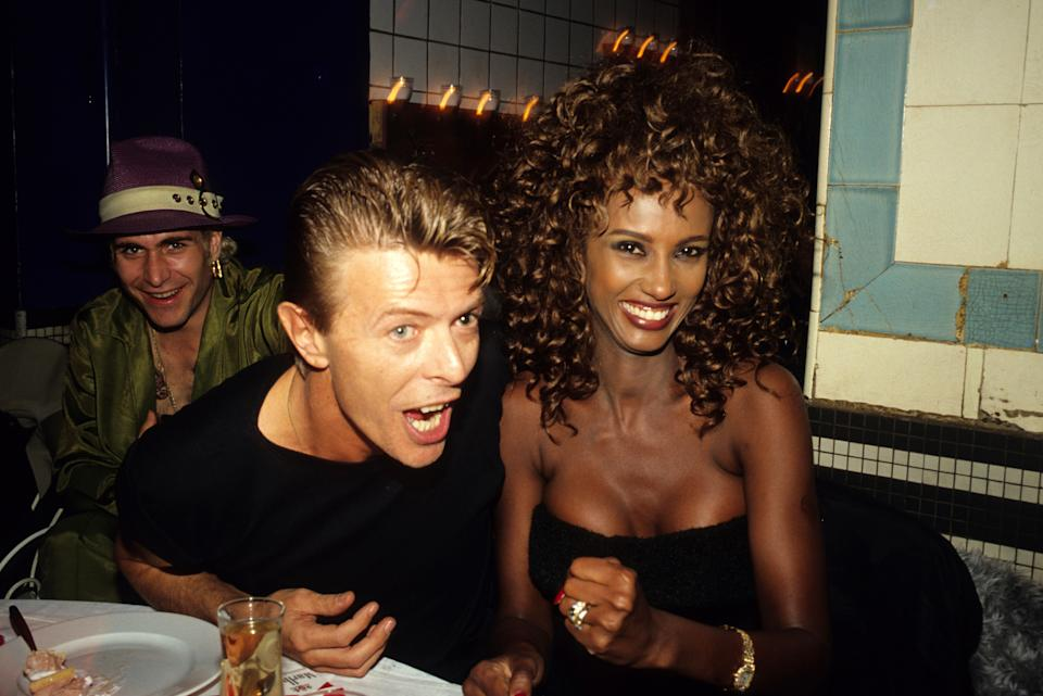 David Bowie and Iman Bowie attend a Venus de La Mode Awards Cocktail Party at the Bains Douches during Paris Fashion Week in the 1990s in Paris, France. (Photo by Foc Kan/WireImage)