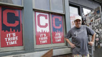 Mike Miller, owner of Wilbert's Food & Music, poses in front of the restaurant before a baseball game between the Minnesota Twins and the Cleveland Indians, Tuesday, Aug. 25, 2020, in Cleveland. The coronavirus pandemic has been especially hard on businesses that rely on ballpark traffic, eliminating crowds at major league games, and leading to rules that limit the amount of people they can have inside their doors at the same time. (AP Photo/Tony Dejak)