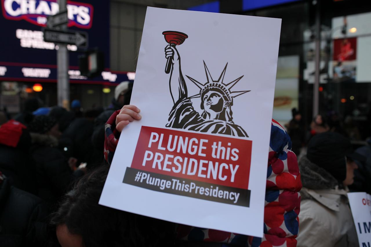 """<p>People gathers in the protest """"Rally Against Racism: Stand Up for Haiti and Africa"""" after President Trump's comments about Haitian and African immigrants at Times Square, New York City on Jan. 15, 2018. (Photo: Anik Rahman/NurPhoto via Getty Images) </p>"""