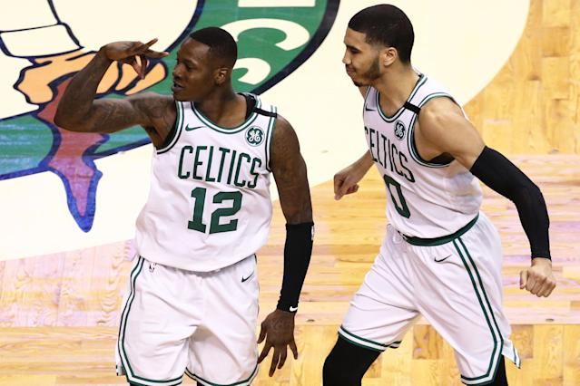 Terry Rozier (left) and rookie Jayson Tatum will have to pick up the offensive slack for the Celtics to challenge the 76ers' defense. (Getty)