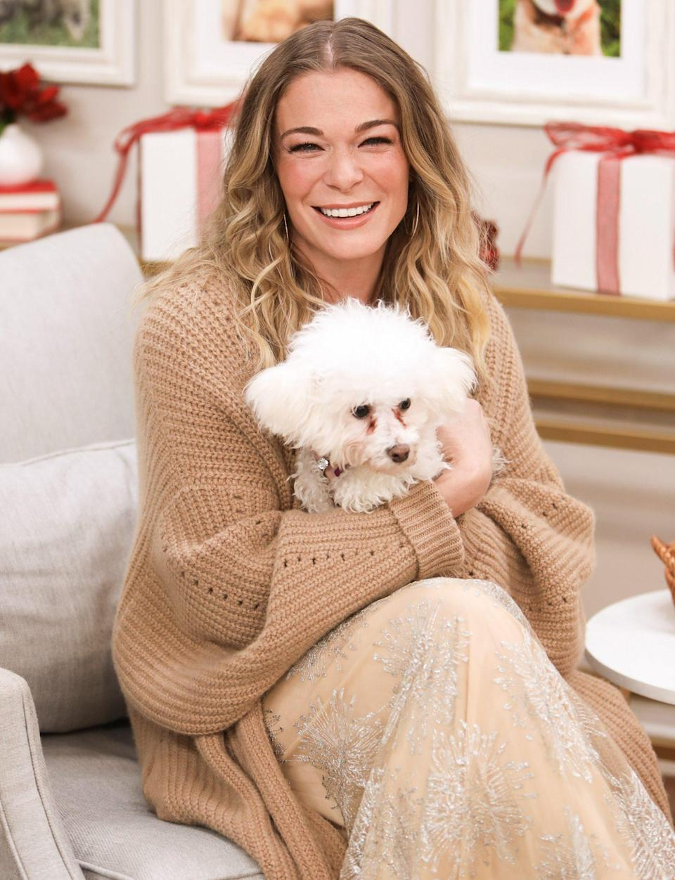 <p>LeAnn Rimes snuggles up with a rescue pup on the set of Hallmark Channel's <em>Home & Family </em>on Thursday in L.A. </p>