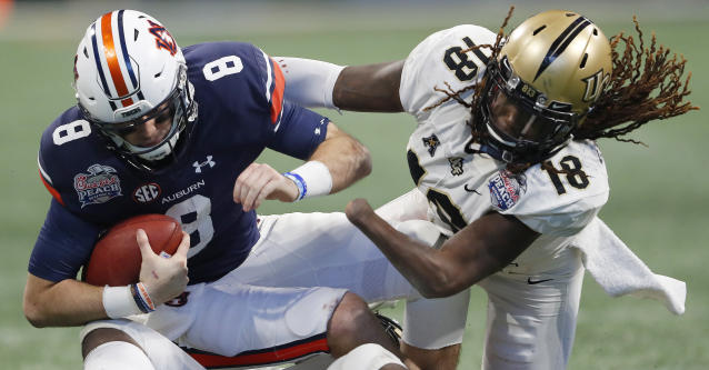 Shaquem Griffin sacks Auburn's Jarrett Stidham at the Peach Bowl. (AP)