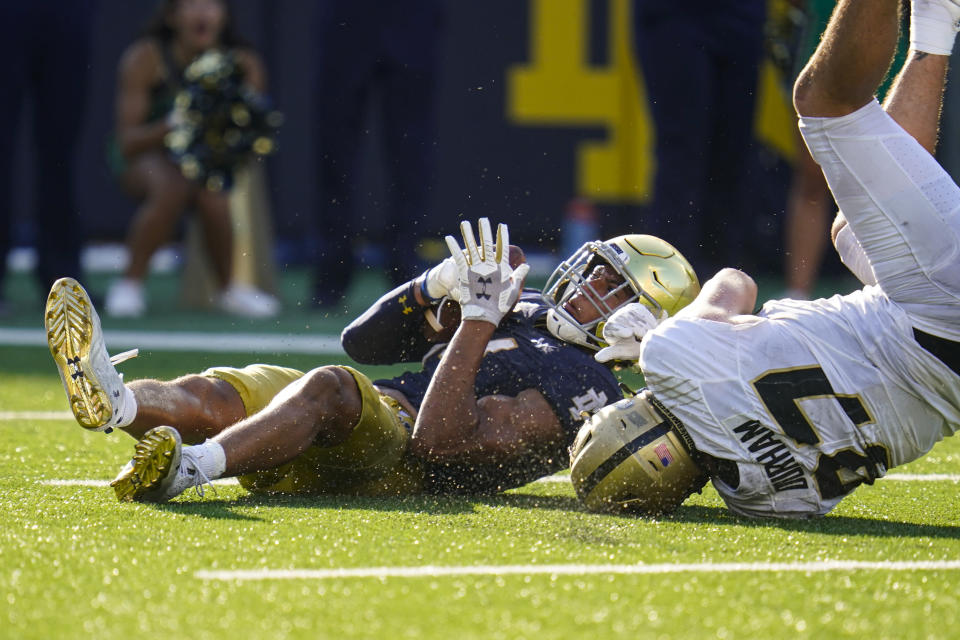 Notre Dame safety Kyle Hamilton (14) intercepts a pass in the end zone intended for Purdue tight end Payne Durham (87) during the second half of an NCAA college football game in South Bend, Ind., Saturday, Sept. 18, 2021. Notre Dame defeated Purdue 27-13. (AP Photo/Michael Conroy)