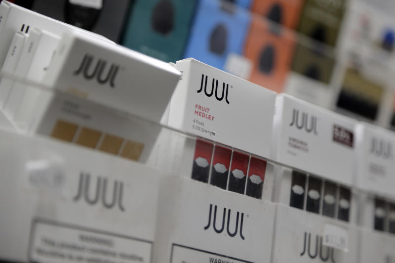 FILE - In this Dec. 20, 2018, file photo Juul products are displayed at a smoke shop in New York. Philip Morris and Altria have ended merger talks and JUUL's CEO is stepping down from the top post as criticism over vaping continues to intensify. The companies confirmed last month that they were in discussions, more than a decade after splitting itself into two companies.  (AP Photo/Seth Wenig, File)