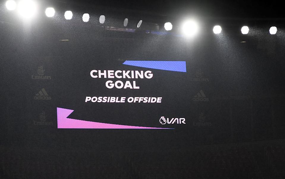 LONDON, ENGLAND - NOVEMBER 08: A screen inside the stadium displays the decision to check VAR for offside after John McGinn of Aston Villa scores his team's first goal during the Premier League match between Arsenal and Aston Villa at Emirates Stadium on November 08, 2020 in London, England. Sporting stadiums around the UK remain under strict restrictions due to the Coronavirus Pandemic as Government social distancing laws prohibit fans inside venues resulting in games being played behind closed doors. (Photo by Andy Rain - Pool/Getty Images)