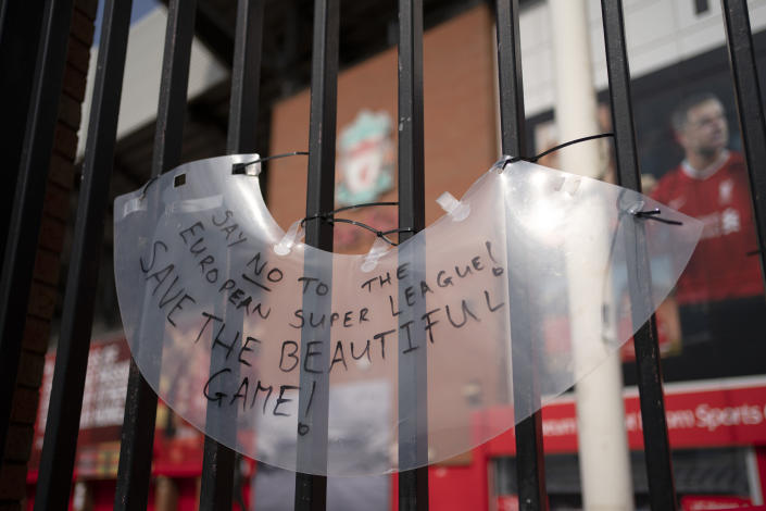 """A sign is seen outside Liverpool's Anfield Stadium after the collapse of English involvement in the proposed European Super League, Liverpool, England, Wednesday, April 21, 2021. Liverpool owner John W Henry has apologised to the club's supporters for the """"disruption"""" caused by the proposed European Super League (ESL). (AP Photo/Jon Super)"""