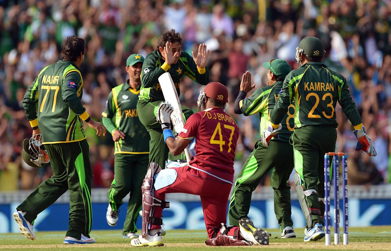 Pakistan's Saeed Ajmal (centre) celebrates taking the wicket of West Indies' captain Dwayne Bravo, lbw for 19 during the ICC Champions Trophy match at The Oval, London.