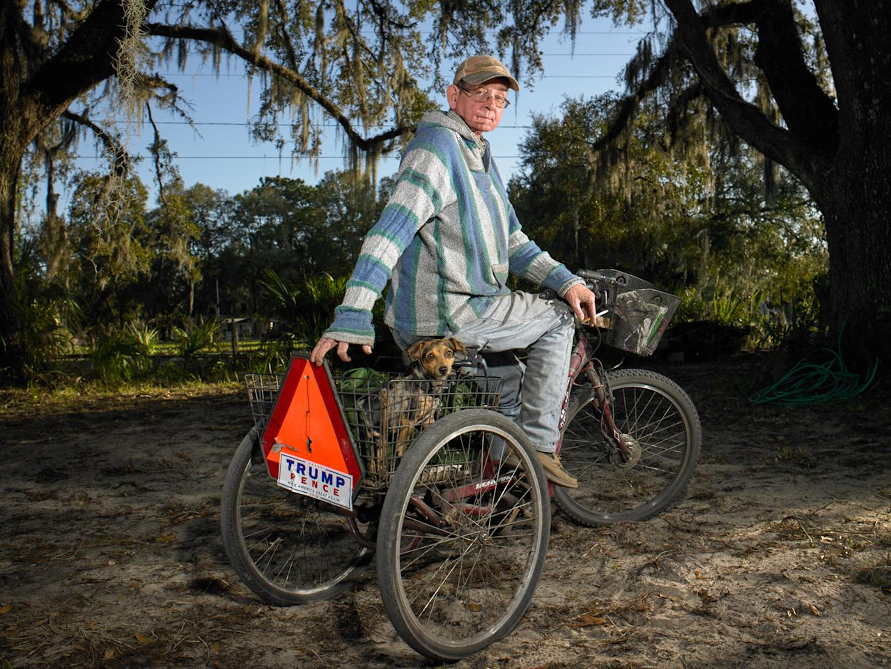 "<p>""Born-again Christian Calvin Moffitt and his dog Shakira live in Cross City, Fla. Although he has a Trump-Pence bumper sticker on his tricycle, he couldn't vote because he's a convicted felon. At the time he told me he hoped they wouldn't repeal Obamacare as he is dependent on it and not old enough for Medicare just yet."" (Photograph and caption by Naomi Harris) </p>"