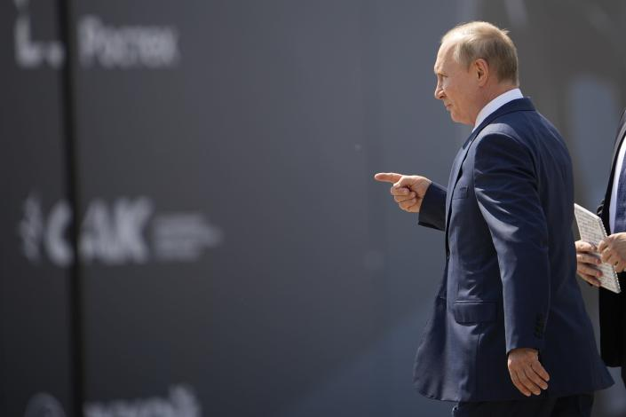 Putin walks to inspect a prototype of Russia's prospective fighter jet at the MAKS-2021 International Aviation and Space Salon in Zhukovsky outside Zhukovsky, Russia, Tuesday, July 20, 2021. Russia on Tuesday unveiled a prototype of its prospective new fighter jet at the Moscow air show. (AP Photo/Alexander Zemlianichenko, Pool)