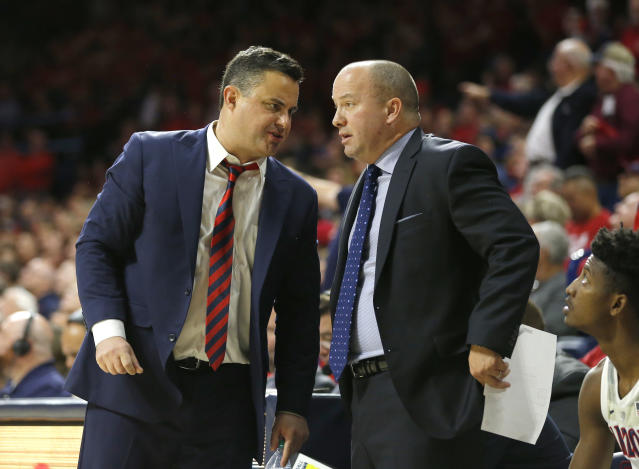 Arizona head coach Sean Miller, left, and assistant coach Mark Phelps in the first half during an NCAA college basketball game against Utah, Saturday, Jan. 5, 2019, in Tucson, Ariz. (AP Photo/Rick Scuteri)