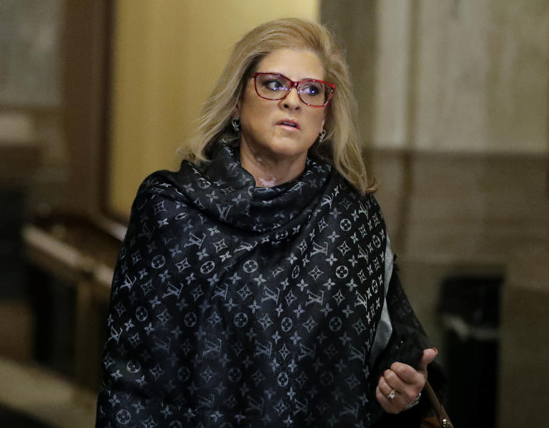 State Rep. Mara Candelaria Reardon arrives for a hearing at the state Supreme Court in the Statehouse, Monday, Oct. 21, 2019, in Indianapolis. Indiana's Attorney General Curtis Hill faces a hearing over whether allegations that he drunkenly groped Reardon and three other women at a bar amounted to professional misconduct. (AP Photo/Darron Cummings)