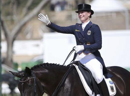 FILE PHOTO: 2016 Rio Olympics - Equestrian - Final - Dressage Individual Grand Prix Freestyle - Olympic Equestrian Centre - Rio de Janeiro, Brazil - 15/08/2016. Isabell Werth (GER) of Germany riding Weihegold Old waves. REUTERS/Tony Gentile Picture Supplied by Action Images