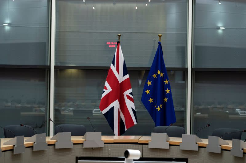 British Union Jack and EU flags are pictured before the meeting with Britain's Brexit Secretary Barclay and EU's chief Brexit negotiator Barnier in Brussels