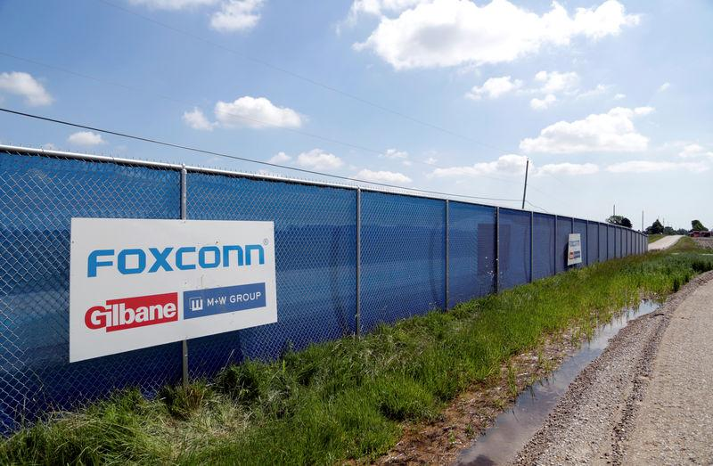 FILE PHOTO: A FoxConn logo is seen before the arrival of U.S. President Donald Trump as he participates in the Foxconn Technology Group groundbreaking ceremony for its LCD manufacturing campus