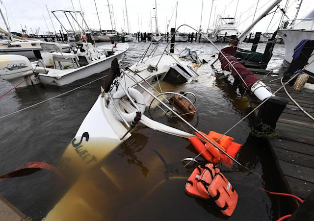 <p>A sunken boar at Rockport Harbor after heavy damage when Hurricane Harvey hit Rockport, Texas on Aug.26, 2017. (Photo: Mark Ralston/AFP/Getty Images) </p>