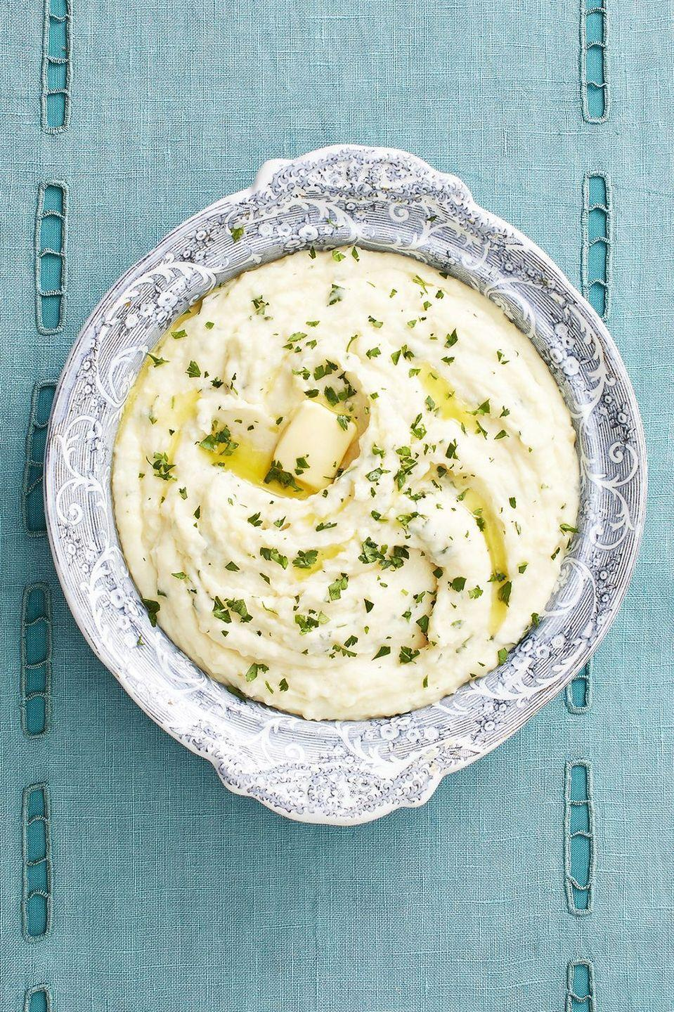 """<p>It takes a little extra time to roast the garlic for these creamy mashed potatoes—but it's so worth it! </p><p><a href=""""https://www.thepioneerwoman.com/food-cooking/recipes/a33314207/roasted-garlic-mashed-potatoes-recipe/"""" rel=""""nofollow noopener"""" target=""""_blank"""" data-ylk=""""slk:Get Ree's recipe."""" class=""""link rapid-noclick-resp""""><strong>Get Ree's recipe.</strong></a></p>"""