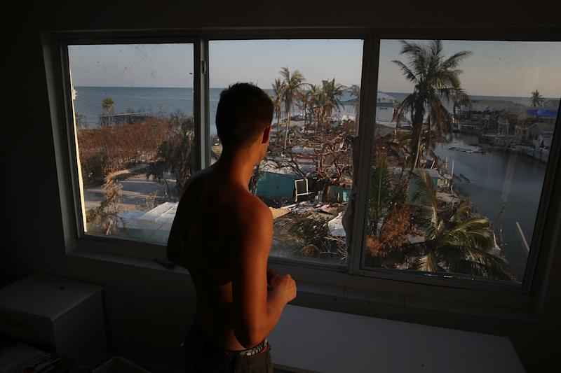 Markus Reinfandt looks out the window of his home onto the mobile homes that were destroyed by Hurricane Irma on Sept.18, 2017, in Marathon, Florida.  (Joe Raedle/Getty Images)
